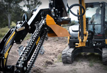 Excavator with a Digga Bigfoot Trencher.