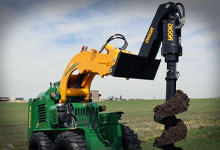 Compact loader with Digga attachments, featuring a Boom Extension, Auger, and Auger Bit.