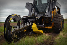 Skid steer loader mounted with a Digga Bigfoot Trencher for digging trenches.