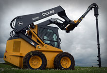 Skid steer loader with a Digga TPE (Drilling & Piling Extension).